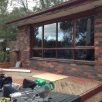 Urban Bi-Folds - Timber bi-fold 4-door unit - Windows on deck changed to bi-folds before
