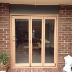 Urban Bi-Folds - Small narrow timber bi-fold 3-door unit onto deck