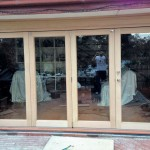 Urban Bi-Folds - Timber bi-fold 4-door unit - Windows on deck changed to bi-folds after